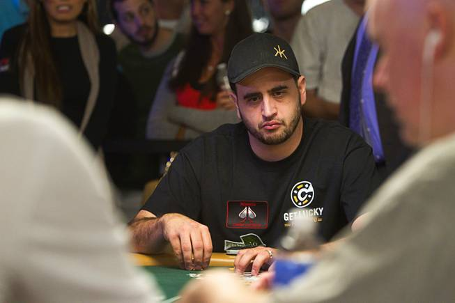 Poker player Robert Mizrachi competes in the $50,000 World Series of Poker's Players' Championship at the Rio Wednesday, June 25, 2014.