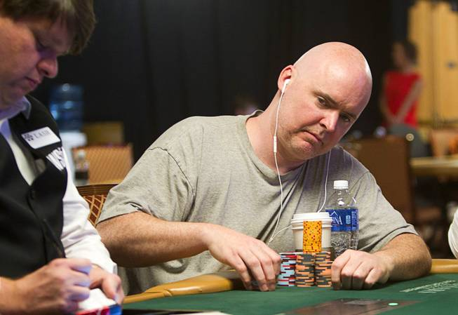 Poke player John Hennigan competes in the $50,000 World Series of Poker's Players' Championship at the Rio Wednesday, June 25, 2014.
