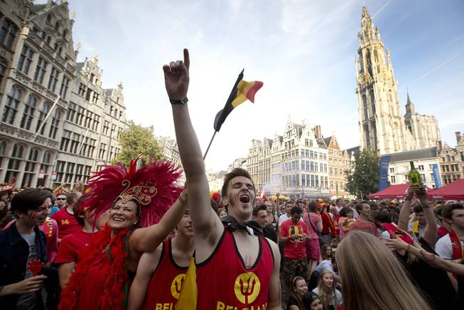 Belgian fans cheer after Belgium scored a goal as they watch the soccer match on a giant screen in the Grote Markt in Antwerp, Belgium on Sunday, June 22, 2014. Belgium scored a 1-0 victory over Russia during the group H World Cup soccer match between Belgium and Russia at the Maracana Stadium in Rio de Janeiro, Brazil.