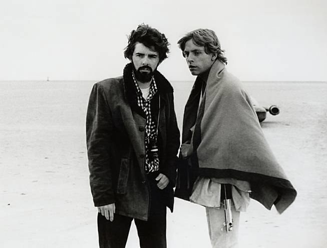 "In this March 1976 publicity photo, director George Lucas and actor Mark Hamill, who portrays Luke Skywalker, are shown on the salt flats of Tunisia during principal photography of the original ""Star Wars."""