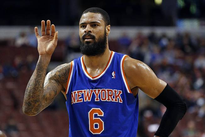In this March 21, 2014, photo, New York Knicks' Tyson Chandler gestures during an NBA basketball game against the Philadelphia 76ers in Philadelphia.