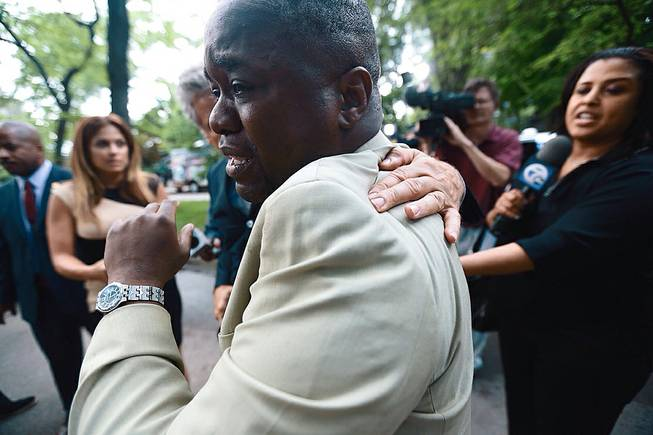 Charlie Bothuell IV becomes emotional after arriving home after the Detroit Police Department found his missing 12-year old son Charlie Bothuell V in the basement of his home in Detroit on Wednesday, June 25, 2014.