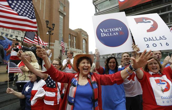 Republican supporters cheer outside the American Airlines Center during a visit by members of the Republican National Committee scouting a 2016 Convention host site in Dallas, Thursday, June 12, 2014.