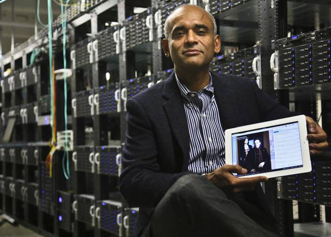 This Dec. 20, 2012, file photo shows Chet Kanojia, founder and CEO of Aereo, Inc., holding a tablet displaying his company's technology, in New York.