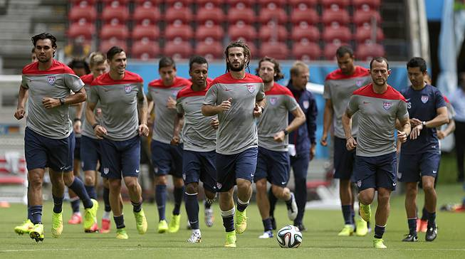 U.S. soccer players congregate on the pitch during a training session Wednesday, June 25, 2014, in Recife, Brazil. The United States will play Belgium in the 2014 World Cup on July 1.