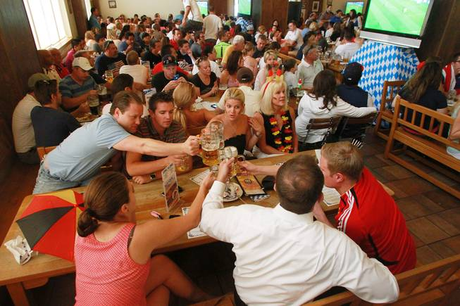 German fans toast at the Hofbrauhaus as the United States takes on Germany in their Group G game at the World Cup in Brazil Thursday, June 26, 2014.
