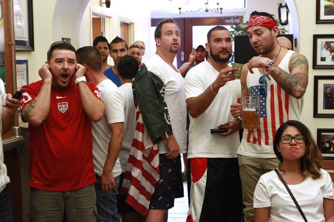 Soccer fans watch televisions at the Hofbrauhaus as the United States takes on Germany in their Group G game at the World Cup in Brazil Thursday, June 26, 2014.