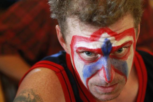 Mike Cobb wears red, white and blue face paint while watching soccer at the Hofbrauhaus as the United States takes on Germany in their Group G game at the World Cup in Brazil Thursday, June 26, 2014.