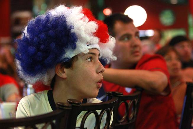 Josue Ruiz, who recently returned from attending early World Cup matches in Brazil, reacts while watching at Shakespeare's Grille & Pub as the United States takes on Germany in their Group G game at the World Cup in Brazil Thursday, June 26, 2014.