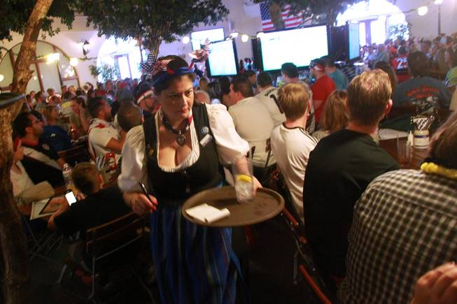 A waitress makes her way through the crowds at the Hofbrauhaus as the United States takes on Germany in their Group G game at the World Cup in Brazil Thursday, June 26, 2014.