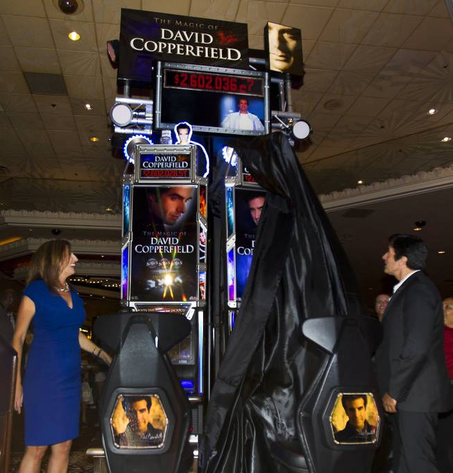 Jean Venneman with Bally and magician David Copperfield unveil his new slot machine at the MGM Grand on Thursday, June 26, 2014.