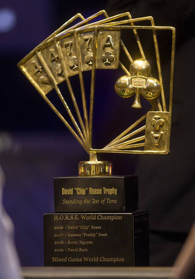 "The David ""Chip"" Reese Trophy sits on the WSOP Poker Players Championship final's table of professional poker players as players face off for the prestigious $50,000 buy-in at the Rio on Thursday, June 26, 2014."