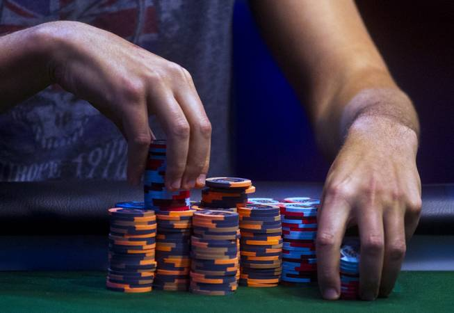 WSOP player Jesse Martin stacks his chips during the Poker Players Championship final table of professional poker players at the Rio on Thursday, June 26, 2014.