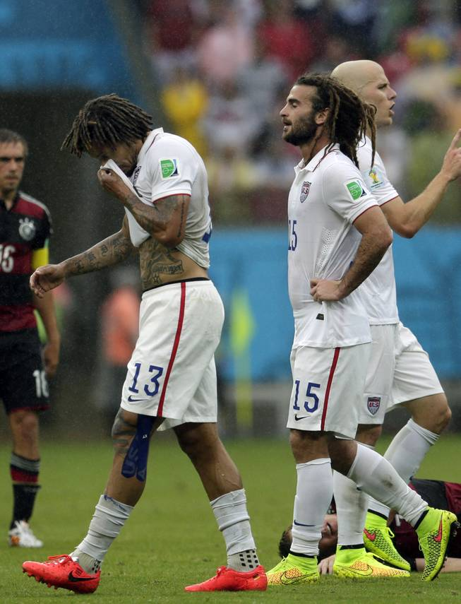 United States' Jermaine Jones (13), Kyle Beckerman (15) and Michael Bradley, far right, walk over the pitch during the group G World Cup soccer match between the USA and Germany at the Arena Pernambuco in Recife, Brazil, Thursday, June 26, 2014.