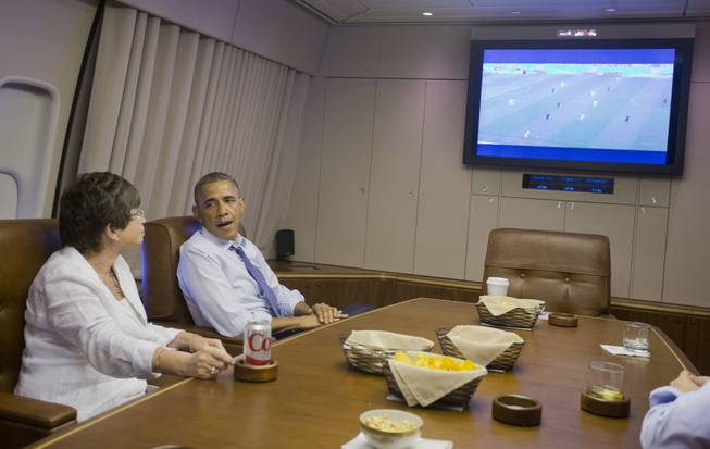 President Barack Obama and White House Senior Adviser Valerie Jarrett watch the World Cup soccer match between US and Germany in the conference room aboard Air Force One en route to Minnesota, Thursday, June 26, 2014.