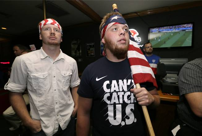Aaron Todd, right, and Zach Crabtree, both of Knoxville, Iowa, watch the World Cup Soccer match between the United States and Germany at a local bar, Thursday, June 26, 2014, in West Des Moines, Iowa. Thousands of eager Americans set work aside on Thursday _ with or without their bosses' OK _ to watch the key World Cup match. Todd and Crabtree said they took the day off to watch the match.
