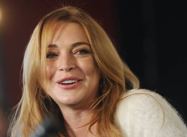 "In this Jan. 20, 2014, photo, actress Lindsay Lohan addresses reporters during a news conference at the 2014 Sundance Film Festival in Park City, Utah. Lohan is suing the makers of ""Grand Theft Auto."" The actress says the latest video game installment used her image and created a character based on her without her permission."