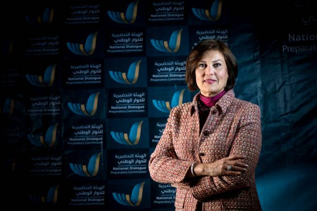 In this March 2014 image released by the National Dialogue Preparatory Commission, Salwa Bugaighis, lawyer and rights activist, poses for a photograph during a meeting in Tripoli, Libya.