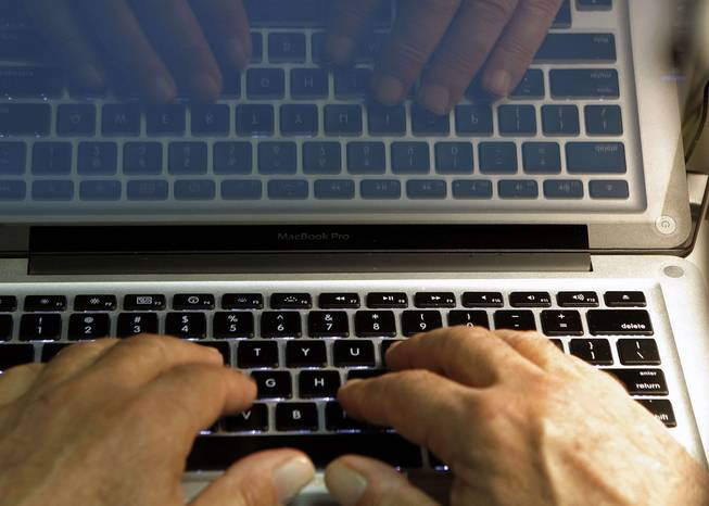 In this Feb. 27, 2013, photo illustration, hands type on a computer keyboard in Los Angeles. Frustration over passwords is as common across the age brackets.