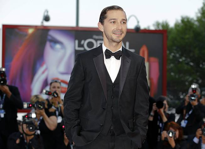"Actor Shia LaBeouf arrives for the premiere of ""The Company You Keep"" at the Venice Film Festival in Venice, Italy, on Sept. 6, 2012. The New York Police Department confirmed Thursday, June 26, 2014, that LaBeouf was removed from a New York City theater for causing a disruption."