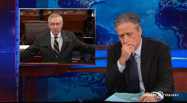 Jon Stewart calls out Senate Majority Leader Harry Reid for his attacks on the Koch brothers' spending on political issues while defending Sheldon Adelson's similar spending.