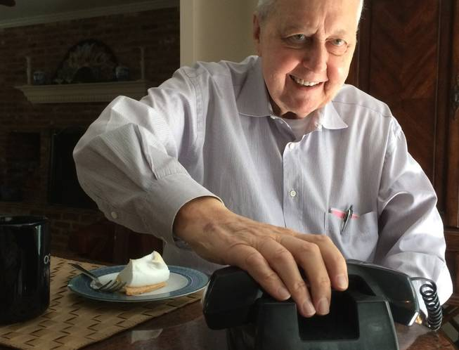 Bob Farquhar, a retired NASA engineer, hangs up from a conference call with his team on June 2, 2014. The group hopes to take control of a retired satellite.