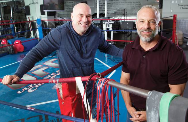 UFC President Dana White, left, and CEO Lorenzo Fertitta were acquaintances in high school, but became fast friends years later at chance meeting at a wedding when they bonded over their enjoyment of combat sports.