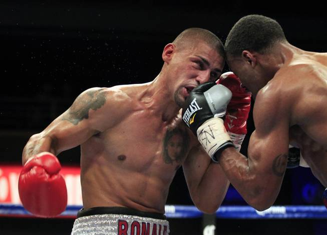 Pennsylvania's Ronald Cruz takes a punch to the face by Errol Spence Jr. as ShoBox: The New Generation on SHOWTIME presents their welterweight fight at the Hard Rock Hotel & Casino on Friday, June 27, 2014.