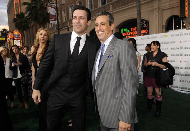 "Jon Hamm, left, and JB Bernstein arrive at the world premiere of ""Million Dollar Arm"" at El Capitan Theatre on Tuesday, May 6, 2014, in Los Angeles."