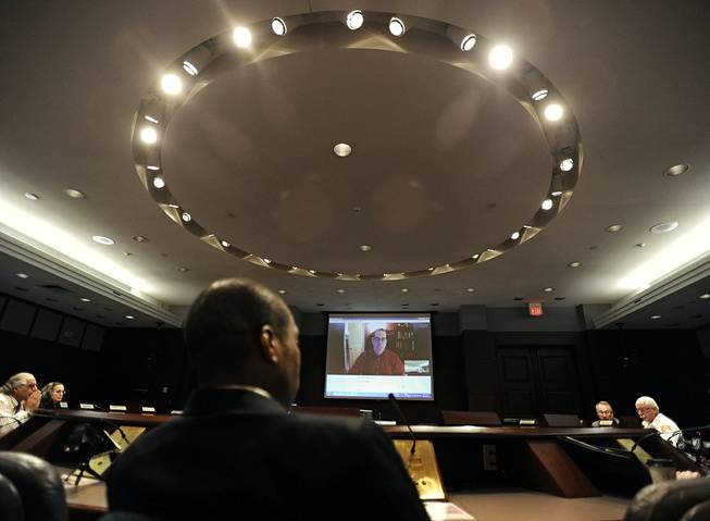 Scott Jackson, mayor of Hamden and chairman of the Sandy Hook Advisory Commission, listens as David Wheeler, father of Sandy Hook School shooting victim Benjamin Wheeler, addresses the commission via Skype at the Legislative Office Building, Friday, June 27, 2014, in Hartford, Conn.
