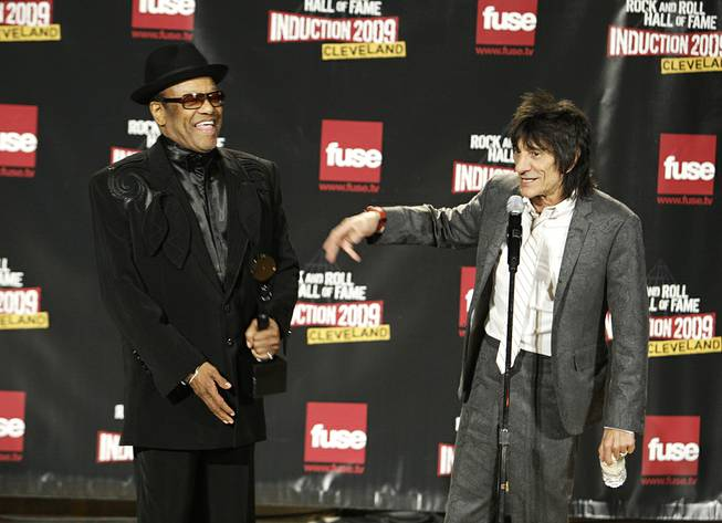 In this April 4, 2009, file photo, Bobby Womack and Ronnie Wood talk backstage after Womack was inducted into the Rock and Roll Hall of Fame at the 2009 Rock and Roll Hall of Fame Induction Ceremony in Cleveland.