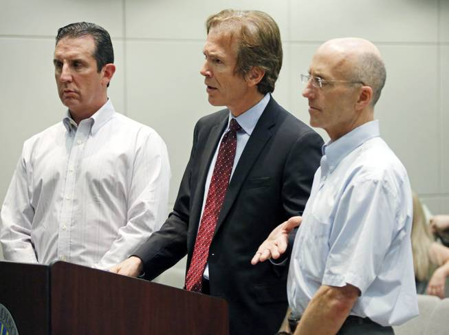In this May 22, 2014, photograph, Mark Mayfield, right, a member of the board of the Central Mississippi Tea Party, and attorney John Reeves, left, listen as Mayfield's attorney Merrida Coxwell, center, responds to questions from city Judge Dale Danks in Madison, Miss., city court, during an initial court appearance. Mayfield, a tea party official charged with conspiring to take photos of U.S. Sen. Thad Cochran's wife inside a nursing home, apparently committed suicide Friday, June 27, 2014, police said, days after Cochran won a nasty Republican primary.