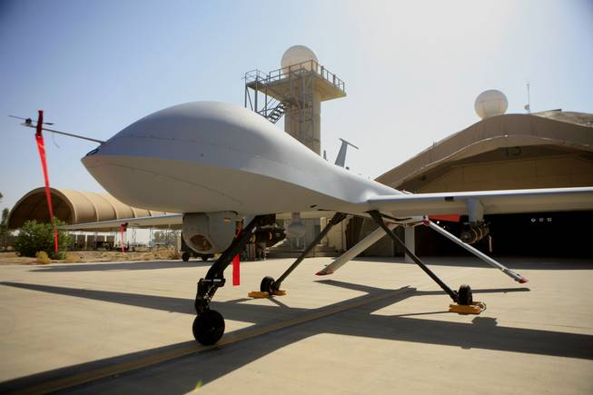 This June 21, 2007, file photo show a MQ-4 Predator drone controlled by the 46th Expeditionary Reconnaissance Squadron stands on the tarmac at Balad Air Base, north of Baghdad, Iraq.