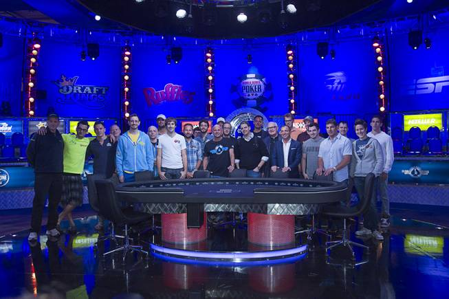 Poker players poses for a photo during opening ceremonies before the start of the Big One for One Drop, a $1,000,000 buy-in No-Limit Hold'em charity poker tournament, at the Rio Sunday, June 26, 2014. The $1 million buy-in is the largest ever for a poker event. Proceeds support One Drop projects in countries experiencing serious difficulties caused by inadequate access to water.