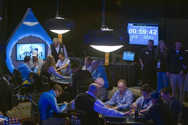 Poker players compete in the Big One for One Drop, a $1,000,000 buy-in No-Limit Hold'em charity poker tournament, at the Rio Sunday, June 26, 2014. The $1 million buy-in is the largest ever for a poker event. Proceeds support One Drop projects in countries experiencing serious difficulties caused by inadequate access to water.