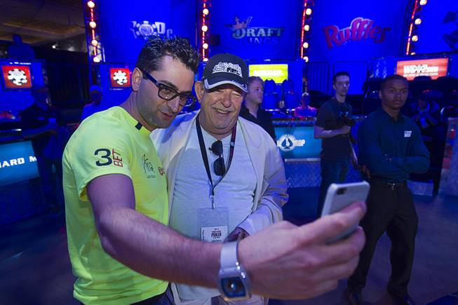 Antonio Esfandiari, the Big Drop for One Drop 2012 champion, takes a selfie with the Las Vegas Sun's Robin Leach before the start of the Big One for One Drop, a $1 million buy-in No-Limit Hold'em charity poker tournament Sunday, June 26, 2014, at the Rio. The $1 million buy-in is the largest ever for a poker event. Proceeds support One Drop projects in countries experiencing serious difficulties caused by inadequate access to water.