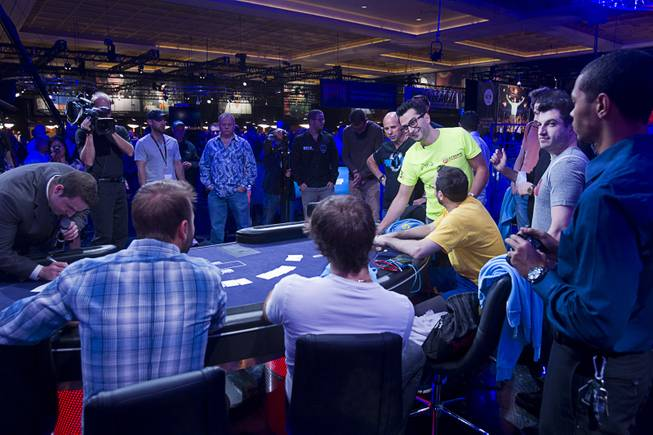 Players select their seats before the start of the Big One for One Drop, a $1,000,000 buy-in No-Limit Hold'em charity poker tournament, at the Rio Sunday, June 26, 2014. The $1 million buy-in is the largest ever for a poker event. Proceeds support One Drop projects in countries experiencing serious difficulties caused by inadequate access to water.
