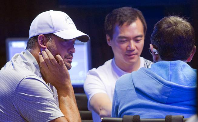 Jean-Robert Bellande, left, competes in the Big One for One Drop, a $1,000,000 buy-in No-Limit Hold'em charity poker tournament, at the Rio Sunday, June 26, 2014. The $1 million buy-in is the largest ever for a poker event. Proceeds support One Drop projects in countries experiencing serious difficulties caused by inadequate access to water.