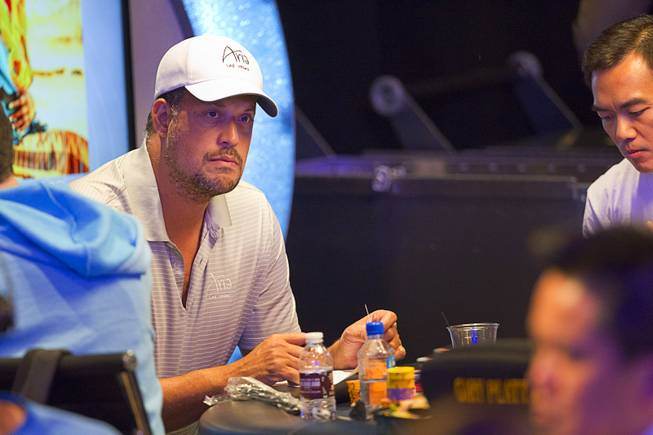 Jean-Robert Bellande waits for play to resume after a break in the Big One for One Drop, a $1,000,000 buy-in No-Limit Hold'em charity poker tournament, at the Rio Sunday, June 26, 2014. The $1 million buy-in is the largest ever for a poker event. Proceeds support One Drop projects in countries experiencing serious difficulties caused by inadequate access to water.
