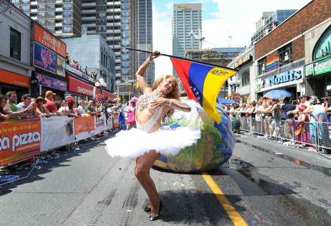 Parade goers celebrate during the WorldPride Parade in Toronto, Sunday, June 29, 2014. The parade, which is the culmination of WorldPride 2014, attracts over a million people.