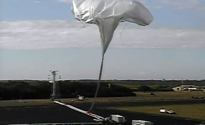 This image taken from video provided by NASA shows the launch of the high-altitude balloon carrying a saucer-shaped vehicle for NASA to test technology that could be used to land on Mars, Saturday, June 28, 2014, in Kauai, Hawaii. Saturday's experimental flight high in Earth's atmosphere tested a giant parachute designed to deliver heavier spacecraft and eventually astronauts.