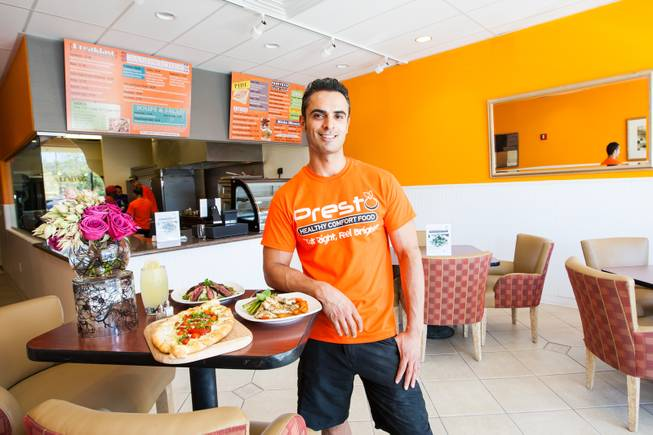 Owner Reza Arshadi prepares for his opening in July at his new restaurant Pesto Cafe located at 19 S. Stephanie Street in Henderson, Nev. Friday, June 28, 2014.