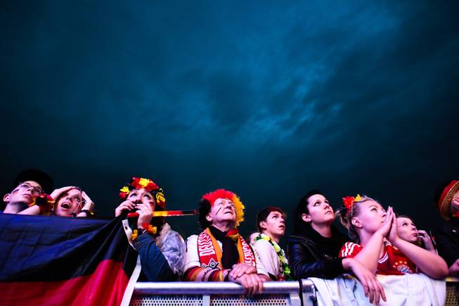 Fans watch the Brazil World Cup round of 16 soccer match between Germany and Algeria at a public viewing event in Berlin, Monday, June 30, 2014. Germany plays Algeria at the Estadio Beira-Rio stadium in Porto Alegre, Brazil, Monday.