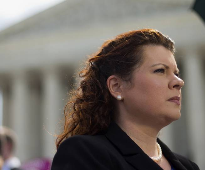 Lori Windham, the attorney representing Hobby Lobby, stands outside the Supreme Court in Washington, Monday, June 30, 2014, following the decision on the Hobby Lobby case. The Supreme Court says corporations can hold religious objections that allow them to opt out of the new health law requirement that they cover contraceptives for women.