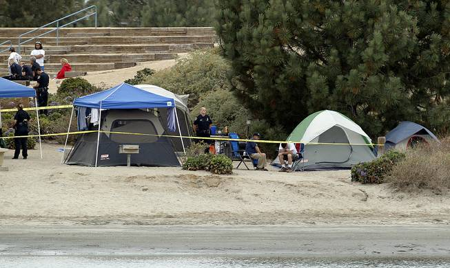 Crime scene tape surrounds tents and campers at the Boy Scout Summer Camp on Fiesta Island Monday, June 30, 2014, after a boy died from a self-inflicted gunshot wound.