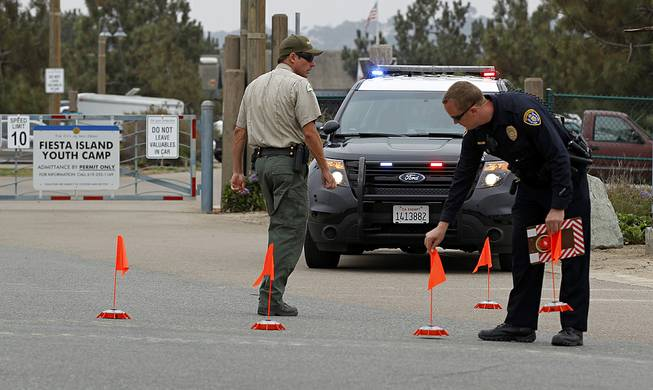Police block the main entrance to the Fiesta Island Youth Camp, where a boy died from a self-inflicted gunshot wound at a Boy Scout camp on Monday, June 30, 2014.