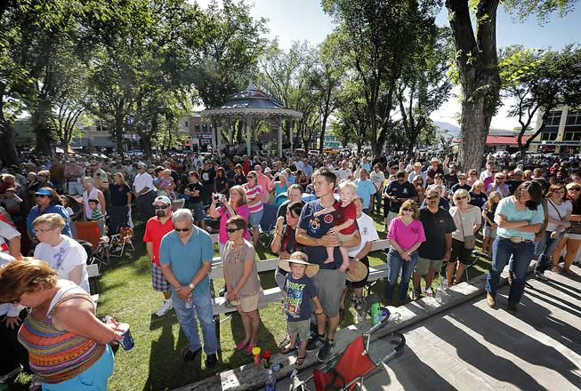People gather to honor the 19 Granite Mountain Hotshots on the first anniversary of their deaths, Monday, June 30, 2014, during a ceremony outside the Yavapai County courthouse in Prescott, Ariz.