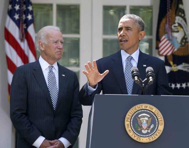President Barack Obama, accompanied by Vice President Joe Biden, speaks about immigration reform, Monday, June 30, 2014, in the Rose Garden at the White House in Washington.