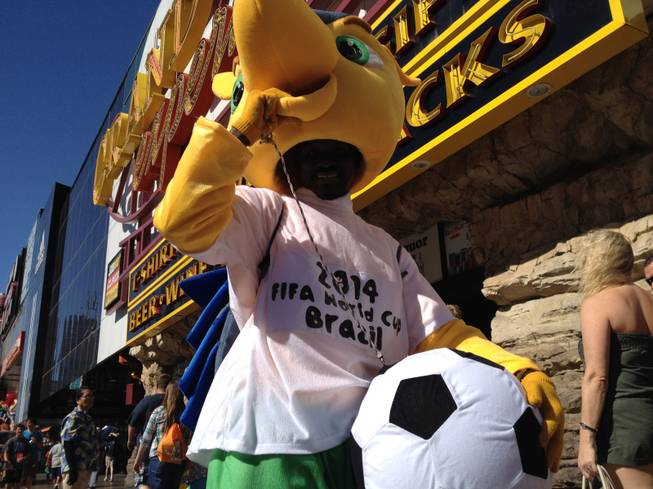 "Street performer Cheikh ""Louis"" Diakhate, dressed as the World Cup mascot Fuleco, stands for a photo on the Las Vegas Strip on Thursday, June 26, 2014."