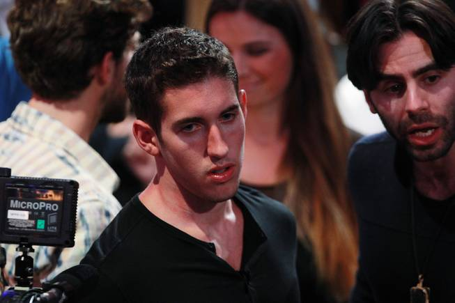 Tournament winner Daniel Colman avoids interviews after winning the final table of the Big One for One Drop tournament at the World Series of Poker on Tuesday, July 1, 2014, at the Rio. Colman took home first place and $15,306,668 in prize money.